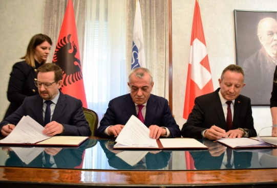 OSCE Secretary General Thomas Greminger with Albania's Speaker of Parliament Gramoz Ruçi and Swiss Ambassador Christoph Graf signing agreement for new support project.
