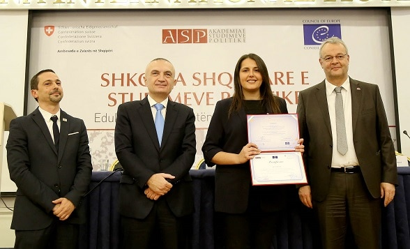 Albania's President Ilir Meta and Swiss Ambassador Adrian Maître handing out diploma certificates to new graduates from the School of Political Studies. ©
