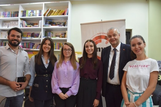 Staff from the National Youth Congress with Swiss Ambassador Adrian Maître at the presentation of youth migration study