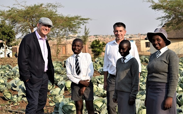 A high level delegation from the Swiss Agency for Development and Cooperation including the Deputy Director, Thomas Gass and the Head of the Eastern and Southern Africa Division, Peter Bieler are shown the garden at Blackfordby Primary School in Harare South, Zimbabwe.