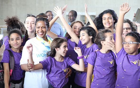 UN Women Executive Director Phumzile Mlambo-Ngcuka with a group of young girls.