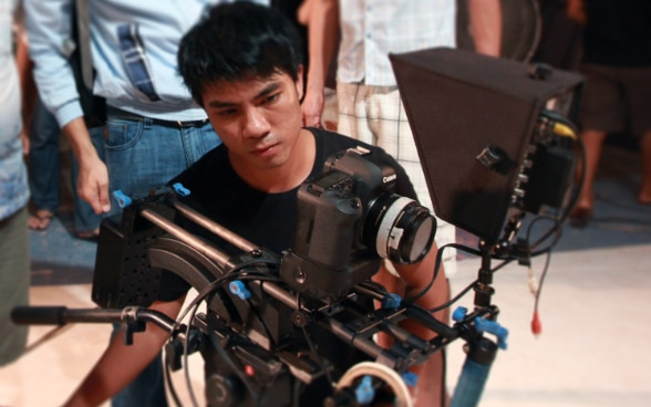 A young director from Myanmar shooting a film.