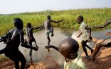 Sudanese children jumping in water