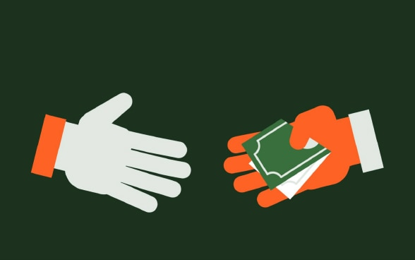 Figure: Two hands coming together in a handshake, with a folded banknote held in the palm of one hand.