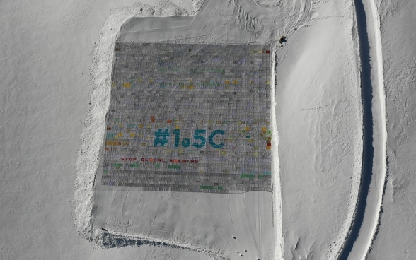 "On the Aletsch Glacier lies the largest postcard in the world. It says ""STOP GLOBAL WARMING # 1.5 °C"" and ""WE ARE THE FUTURE GIVE US A CHANCE""."