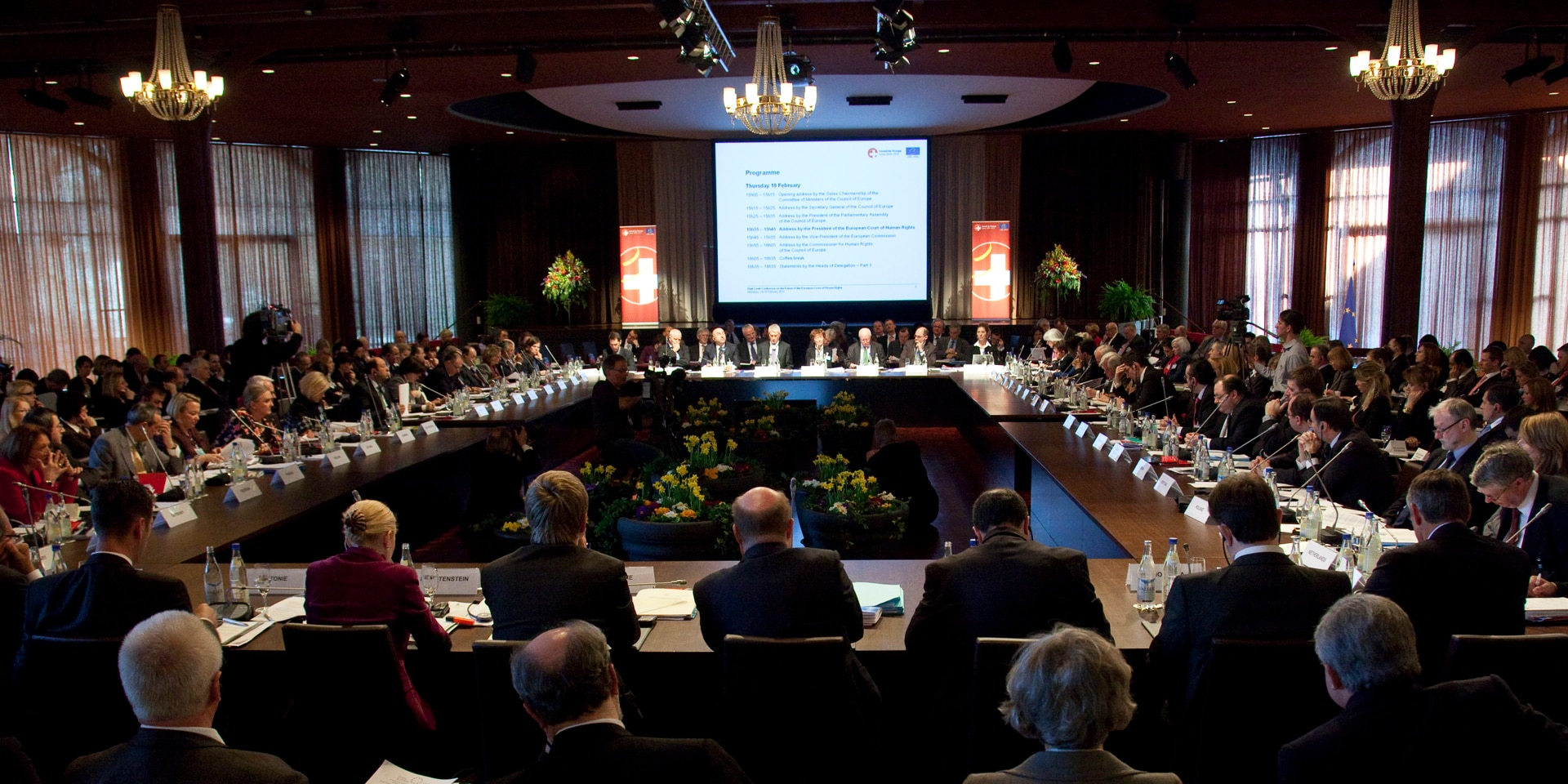 The photo was taken at the Council of Europe Ministerial Conference in February 2010 in Interlaken: it shows a room full to bursting with participants.