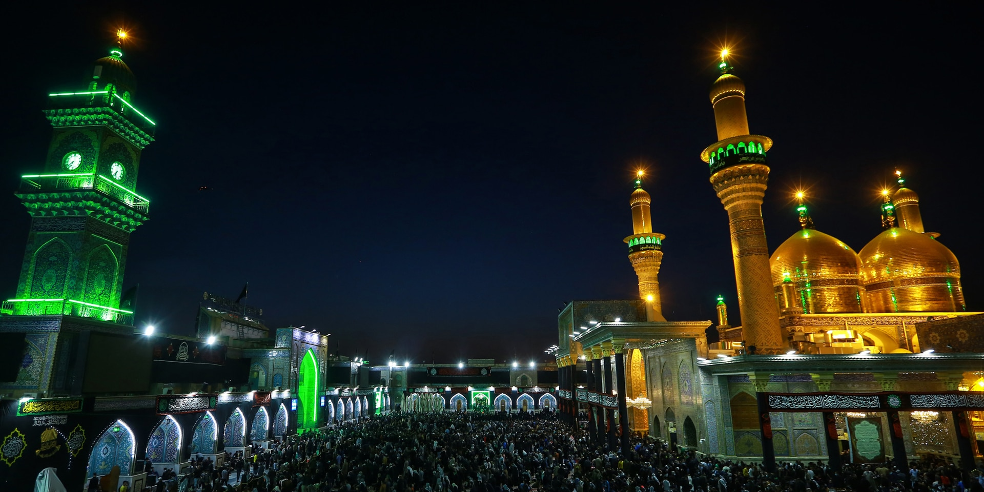 Picture of an illuminated mosque in the Iraqi capital, Baghdad, at night.