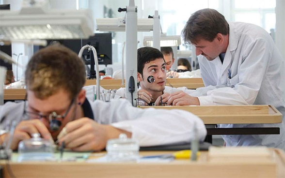 Apprentices in watch factory in Grenchen