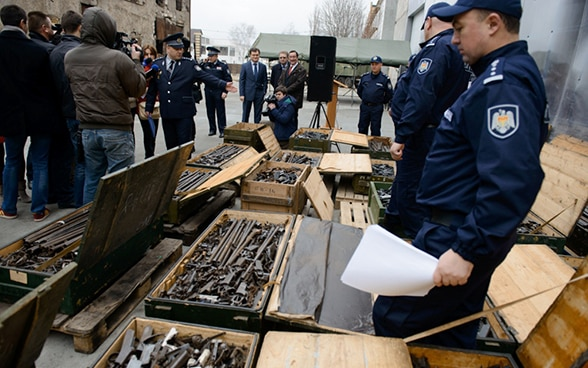 Moldovan police sort through and destroy weapons in Chisinau, 2013
