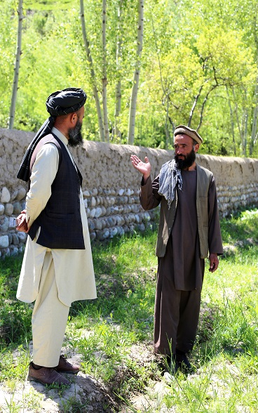 Mawlawi Abdul Qahar (L), head of Tolo Fruit Cooperative visiting the fruit nursery of Sarajuddin pictured (R)