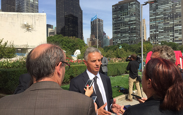 Federal Councillor Didier Burkhalter speaks to journalists in front of the United Nations Headquarters in New York.
