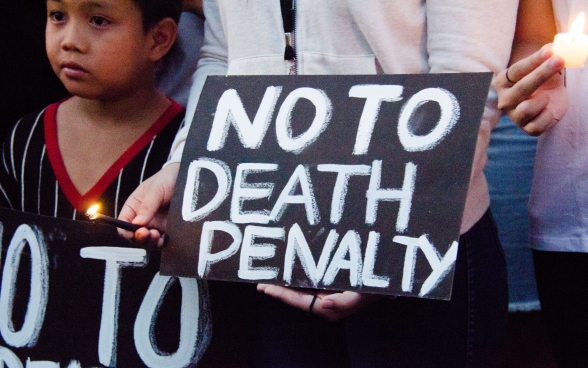 March 2017, Manila, Philippines Demonstrators hold up a black sign that says: No to death penalty.