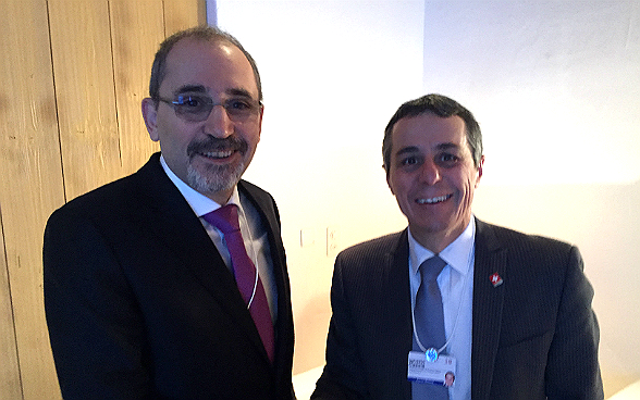 Federal councillor Ignazio Cassis meets Ayman al Sadafi, the Jordanian foreign minister, during the World Economic Forum.
